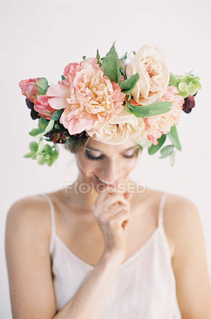 Woman in floral crown biting finger — Stock Photo