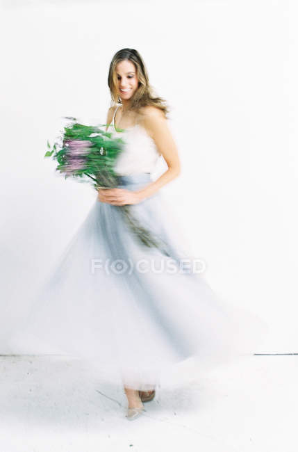 Woman in tulle dress turning around — Stock Photo