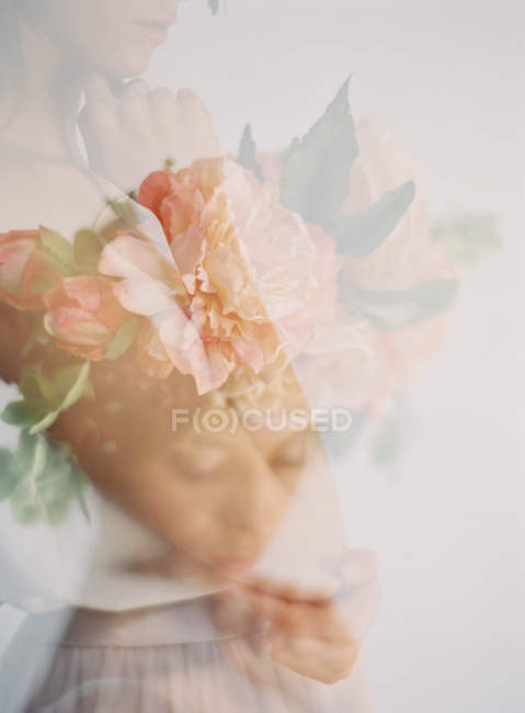 Woman in flower crown and hand to chin — Stock Photo