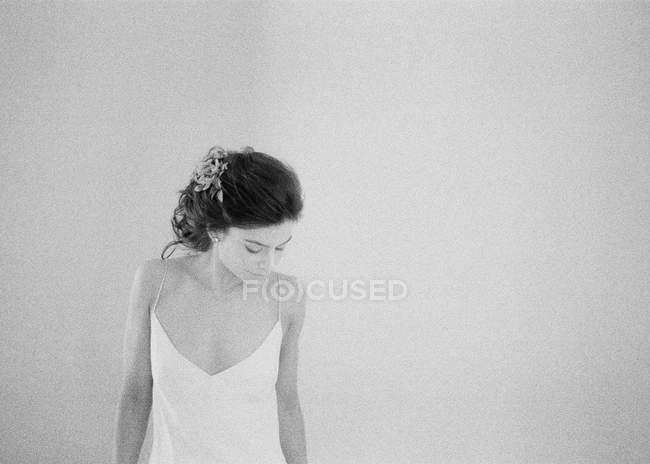 Woman in boudoir looking down — Stock Photo