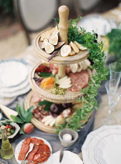 Festive table with assortment of fruits and meat — Stock Photo