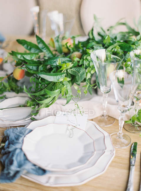 Setting table decorated with leaves and fruits — Stock Photo