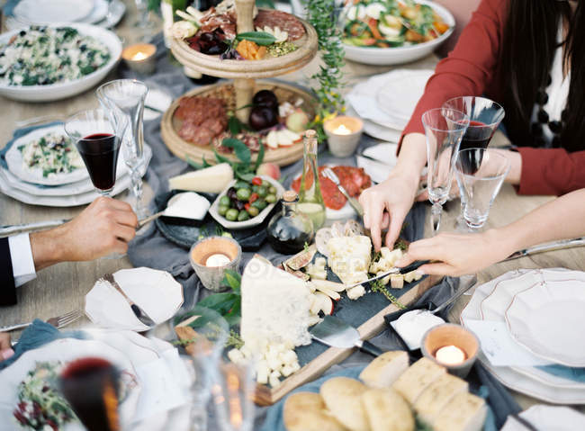 People celebrating at setting table — Stock Photo