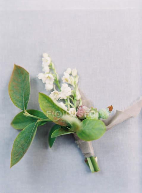 Wedding boutonniere with ribbon — Stock Photo