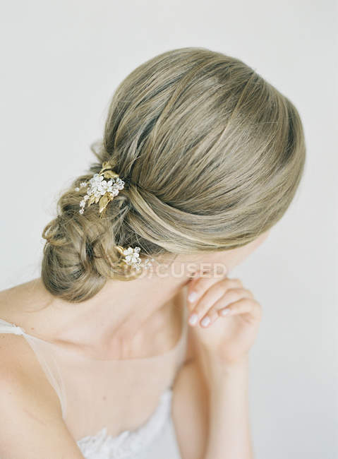 Female hair with delicate flower decoration — Stock Photo