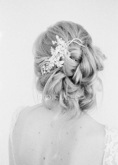 Elegant hairdo and hair decoration — Stock Photo