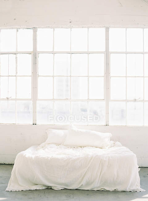Rumpled sheets on bed — Stock Photo
