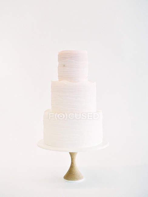 Wedding cake with layers of icing — Stock Photo