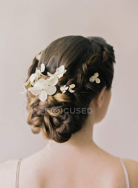 Hair with weaven in flowers — Stock Photo