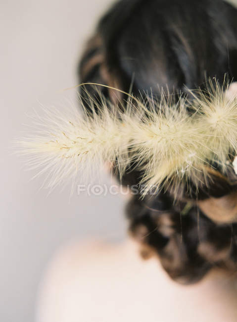 Woman hair with floral decoration — Stock Photo