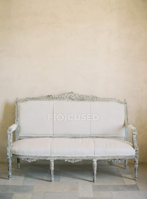 Beige vintage sofa — Stock Photo