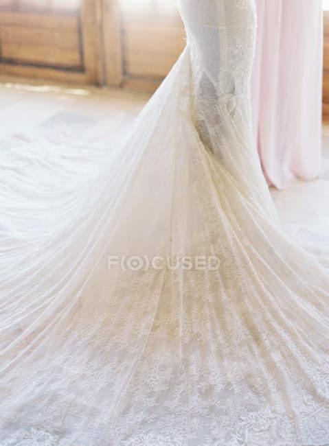 Bride standing in wedding dress — Stock Photo