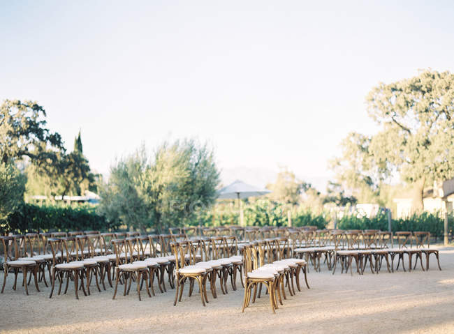 Rows of chairs set outside — Stock Photo