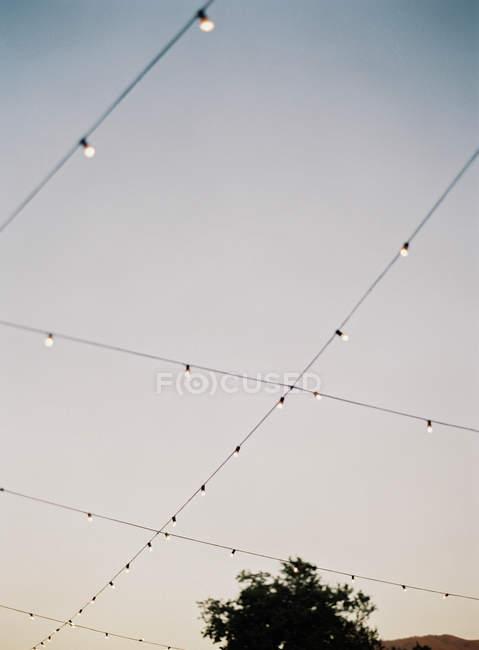 Decorative garlands hanging outdoors — Stock Photo