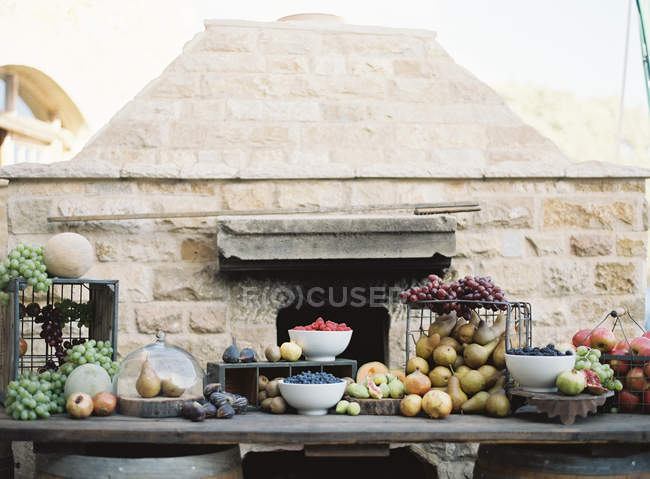 Fresh fruits on improvised table outdoors — Stock Photo
