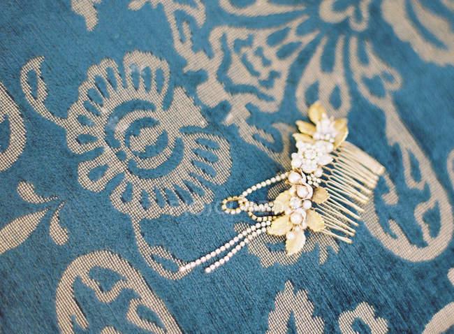 Antique hair-slide with precious gems — Stock Photo