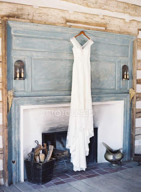Bridal dress hanging — Stock Photo