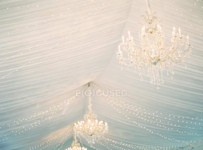 Chandeliers lighting in room — Stock Photo