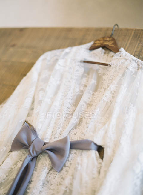 Wedding dress with silk belt — Stock Photo