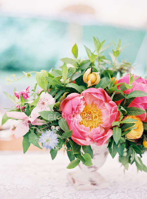 Fresh cut bouquet with peonies — Stock Photo