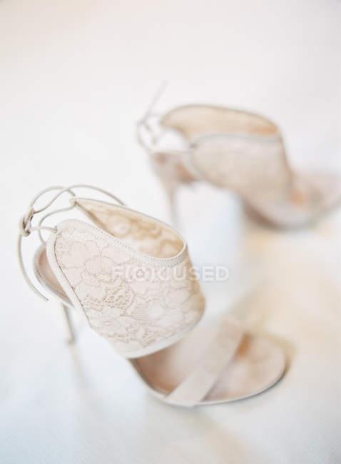 Bridal high-heeled shoes — Stock Photo