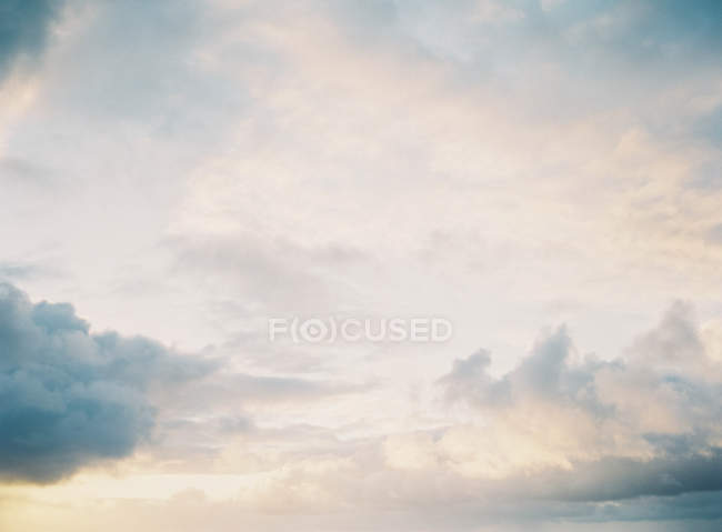 Clouds-cape over calm ocean — Stock Photo