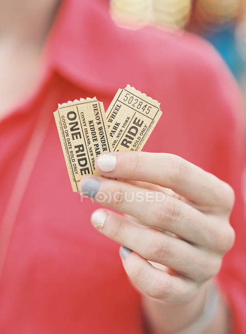 Female hands holding two tickets — Stock Photo