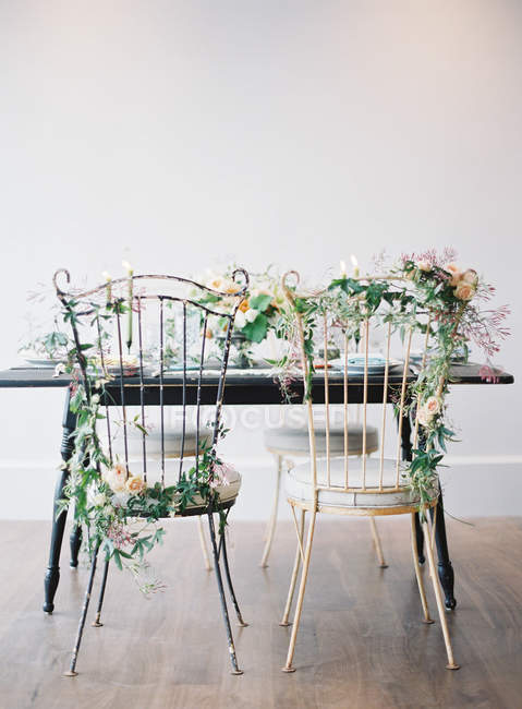 Chairs decorated with flowers — Stock Photo