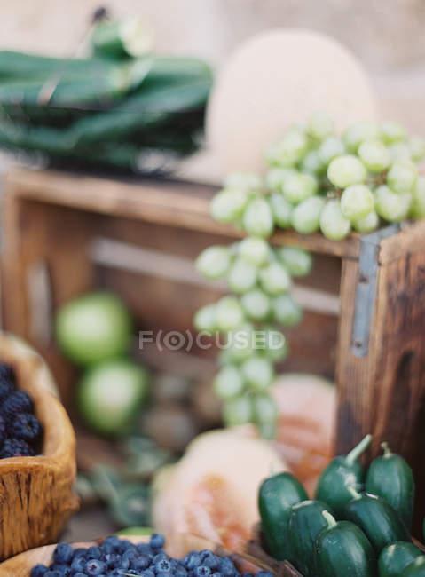 Fresh berries and zucchinis — Stock Photo