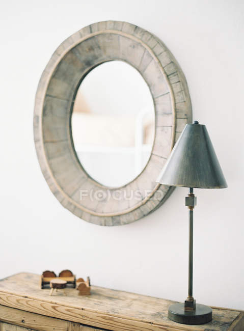 Vintage wooden mirror and lamp — Stock Photo