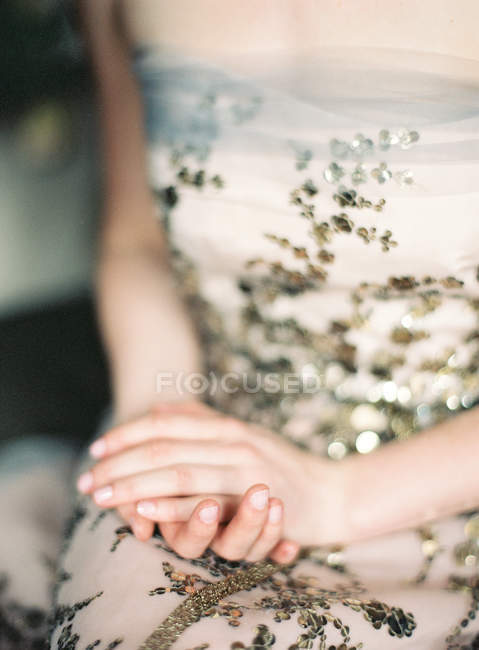 Young woman in decorated dress — Stock Photo