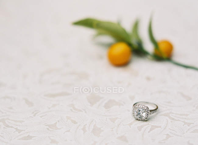 Wedding ring on tablecloth — Stock Photo