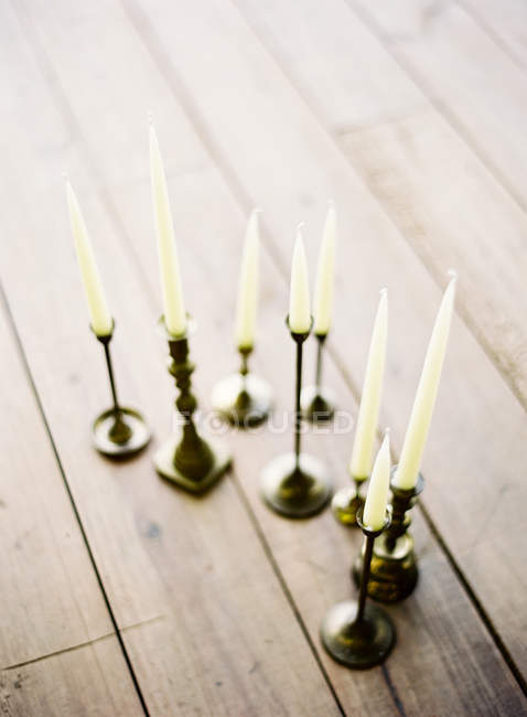 Wax candles in elegant candle holders — Stock Photo