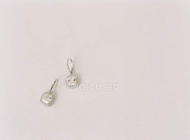 Precious earrings with gems — Stock Photo