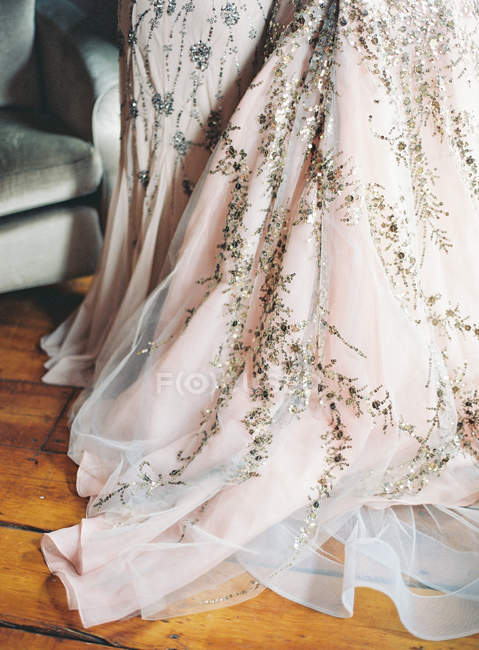 Wedding dress decorated with spangles — Stock Photo