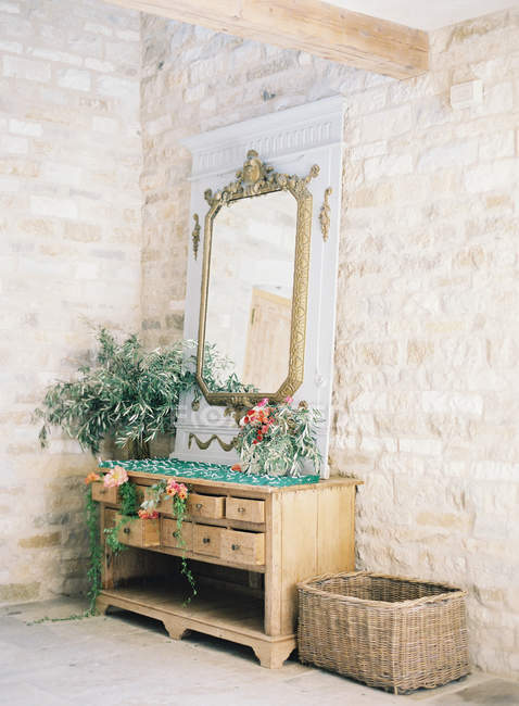 Vintage dresser decorated with flowers — Stock Photo