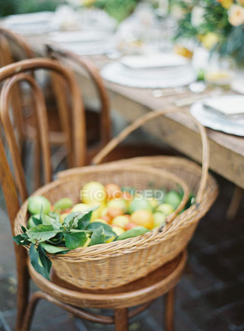 Basket with fresh citrus fruits — Stock Photo