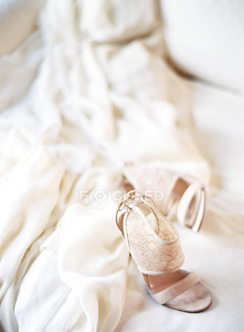 Wedding dress and shoes — Stock Photo