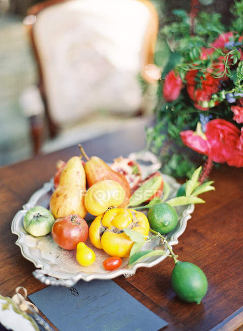 Antique plate with fresh fruits — Stock Photo