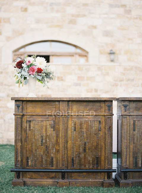 Bouquet of flowers on cupboard — Stock Photo