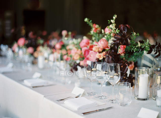 Setting table decorated with flowers — Stock Photo