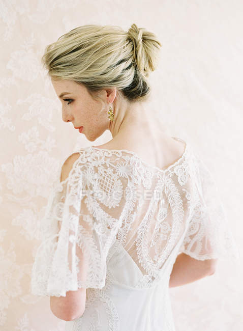 Young woman in wedding dress — Stock Photo