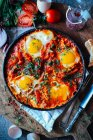 Fried eggs with herbs in frying pen — Stock Photo