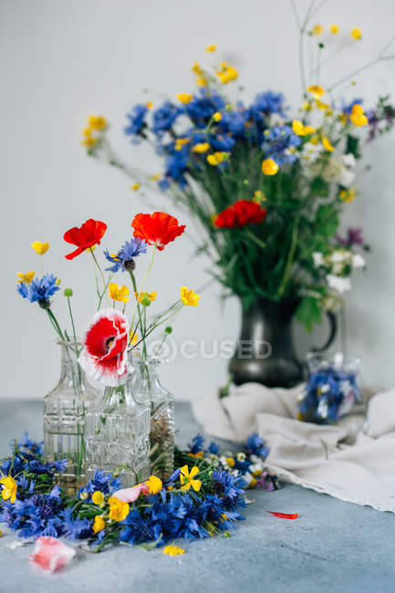 Flowers in glass jars — Stock Photo