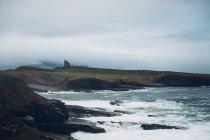 Rocky beach with stormy sea — Stock Photo