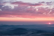 Gorgeous sunset over remote mountains — Stock Photo
