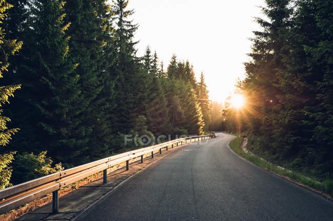 Sunset over mountain road — Stock Photo