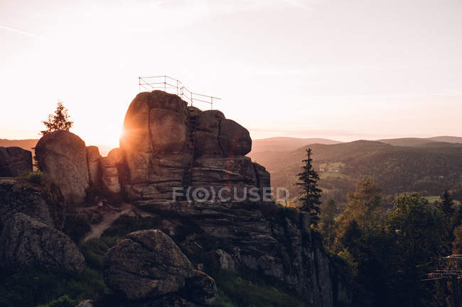 Sunset over cliff — Stock Photo