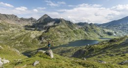Female hiker stretching arms at Schladming Tauern mountains, Schladming, Styria, Austria, Europe — Stock Photo