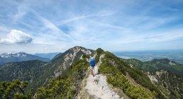 Hiker walking on trail — Stock Photo